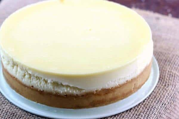 Plain cheesecake recipe is the best homemade cheesecake ever AND the perfect foundation for thousands of variations! Here's the secret to a perfectly smooth top! From RestlessChipotle.com