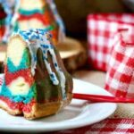 So pretty! Perfect for summer holidays, this tangy red white & blue bundt cake is sweet and delicious with a tunnel of cheesecake filling right through the center. From restlesschipotle.com
