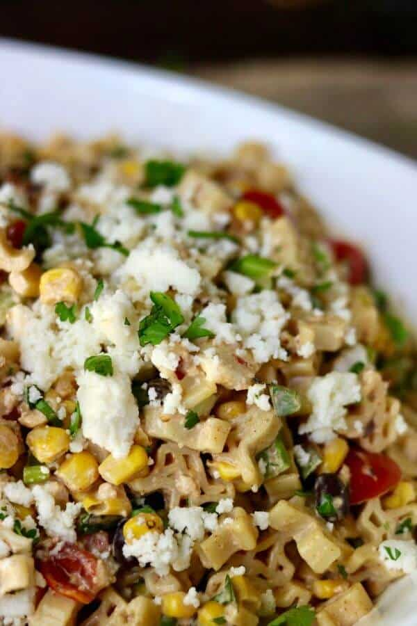 Family favorite! Spicy Tex Mex pasta salad is so good! From restlesschipotle.com