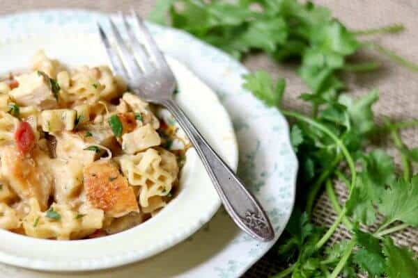 Southwest Chicken Pasta is a family favorite weeknight meal. Tender chicken in a cheesy, creamy southwestern sauce is mixed with pasta and done in 30 minutes. From restlesschipotle.com
