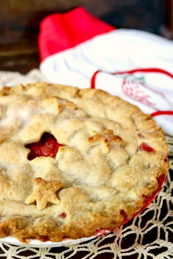 Just like Grandma's! Old fashioned strawberry rhubarb pie recipe is a perfect combination of sweet and tangy with a gorgeous bright crimson filling surrounded by buttery pastry. From RestlessChipotle.com
