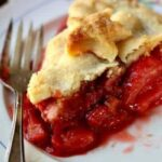 Old fashioned strawberry rhubarb pie recipe is a perfect combination of sweet and tangy with a gorgeous bright crimson filling surrounded by buttery pastry. Old fashioned goodness! From RestlessCHipotle.com