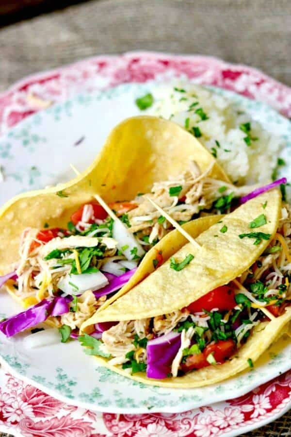 Slow cooker tequila lime chicken tacos are perfect for a simple weekday dinner or weekend taco bar!from RestlessChipotle.com