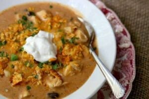 Creamy chicken enchilada soup recipe is ready in minutes! From RestlessChipotle.com