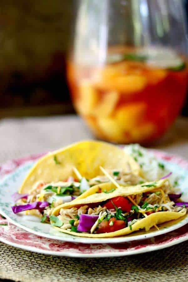 Slow cooker tequila lime chicken tacos is an easy Tex-Mex dinner recipe that cooks right in your crock pot all day long. Use chicken thighs or breast for a deliciously easy weeknight meal! From RestlessChipotle.com