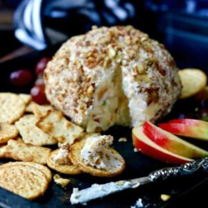 Quick and easy apple cheddar cheese ball recipe is sumptuously full of fall flavors from tangy apple and maple to sharp cheddar and toasted pecans. Easy holiday appetizers! From RestlessChipotle.com