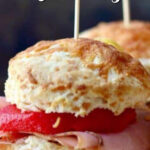 Closeup of ham sliders with text overlay for Pinterest.