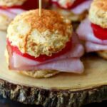 Embrace Fall recipes & flavors with these easy Spiced Apple & Ham Sliders on fluffy Cheddar biscuits! Perfect for game day get-togethers and lazy autumn afternoons. Try smoked turkey in place of the ham! From RestlessChipotle.com