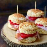 Quick and easy spiced apple and ham sliders on Cheddar cheese biscuits - just right for game day or relaxed weekend noshing. from RestlessChipotle.com