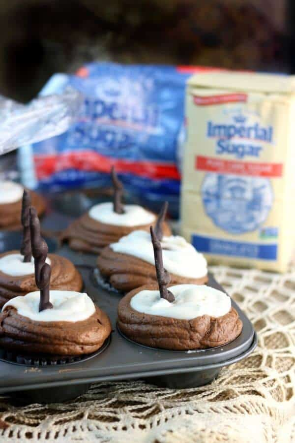 A pan of Mexican hot chocolate cupcakes with Imperial sugar in the background of the image.