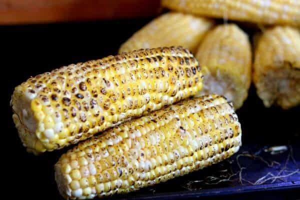 Fire roasted corn is bright yellow with blackened areas on the kernels
