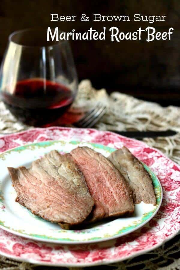 Sliced beef round roast on a red transferware plate with a glass of wine in the background - title image
