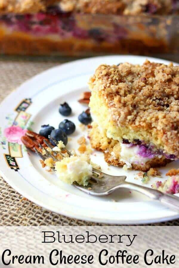 blueberry cream cheese coffee cake square on a white plate with a silver fork. Title image