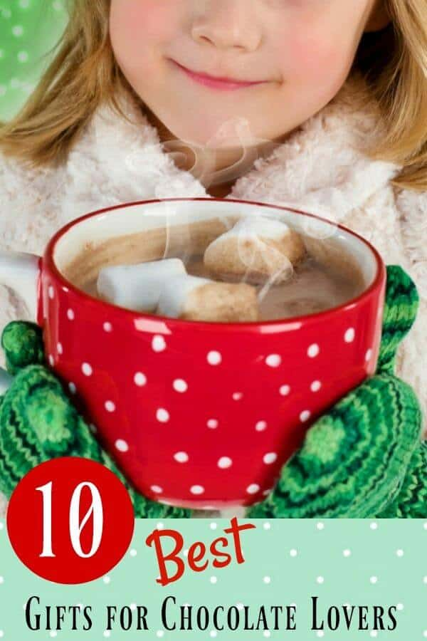 Little girl holding a red cup of hot chocolate with marshmallows- best gifts for chocolate lovers title image