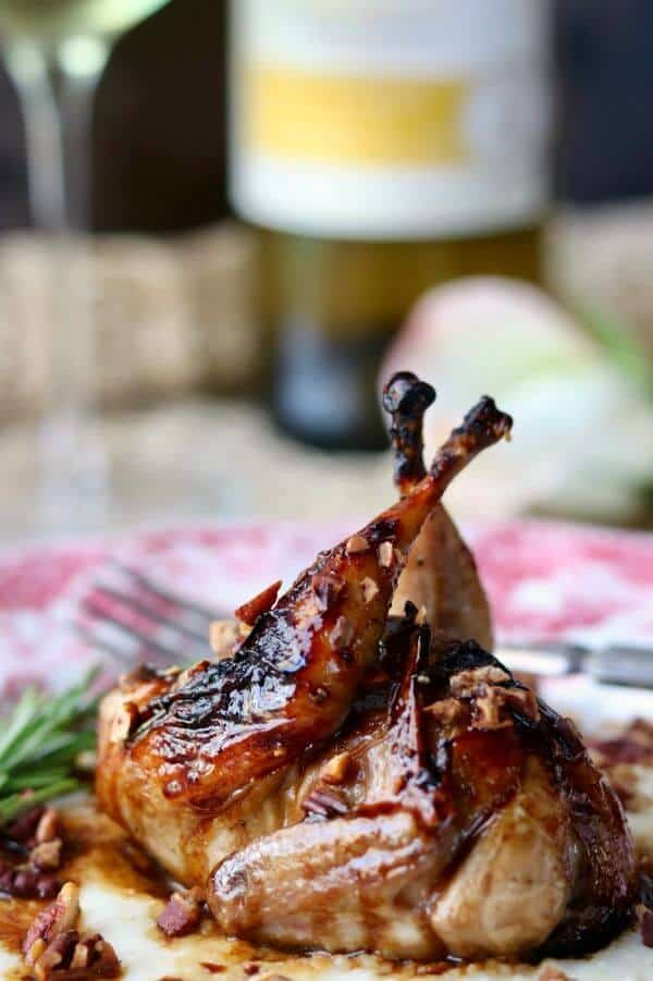 Glazed roasted quail with wine in the background. Link to CK Mondavi and family website