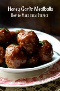 Honey garlic meatballs in a white bowl on a red transferware plate - title image