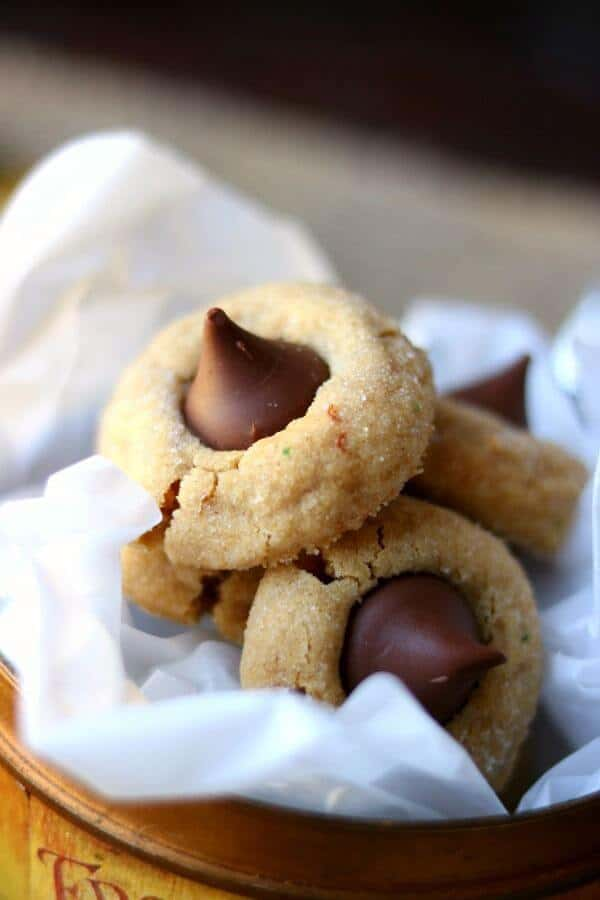 Peanut butter blossoms cookie in a metal container with white tissue paper - peanut butter blossoms recipe image 3