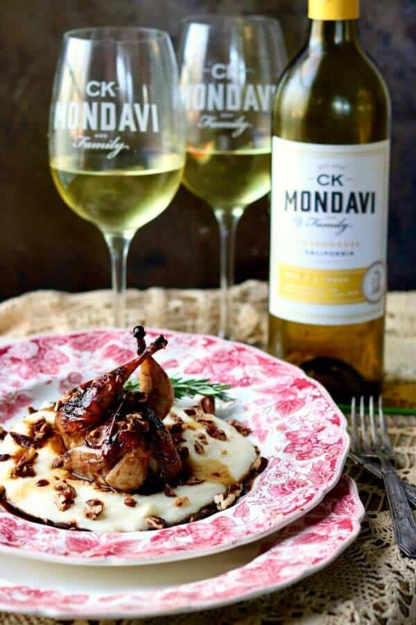 Roasted quail on a plate wine in background - link to ck mondavi and family website