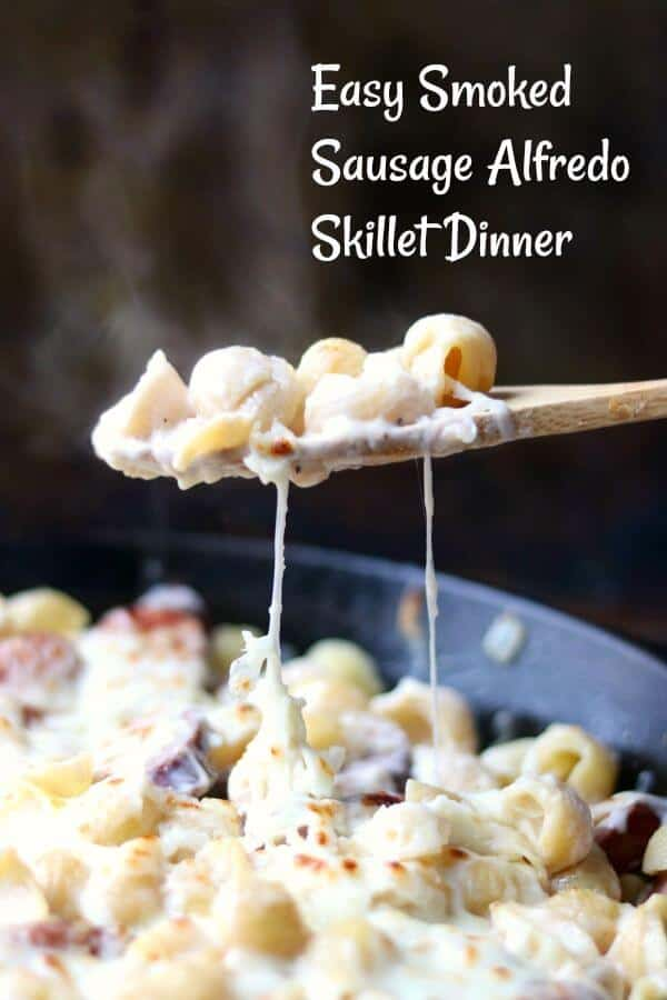 Sausage Alfredo skillet dinner! Tender pasta, smoky sausage, sweet caramelized onions are stirred into a creamy Alfredo sauce to create this easy dinner recipe! Shredded mozzarella cheese is sprinkled over the top and the dish is placed under a broiler to create a gooey, golden topping. 30 minute dinner! Family Friendly recipe. from RestlessChipotle.com #comfortfood #smokedsausage