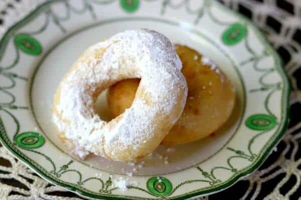 One glazed and one confectioner's sugar donut made from this homemade donut recipe