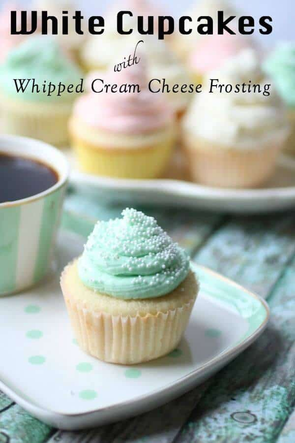 Title image for white cupcakes recipe post - pastel green, pink, and white frosted cupcakes