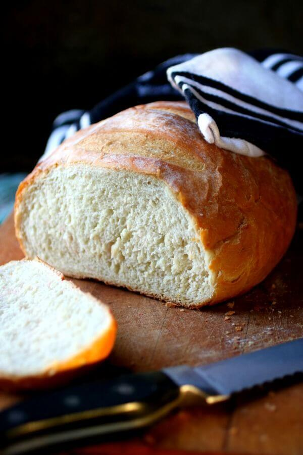 Crusty Artisan bread sliced open to show interior texture.
