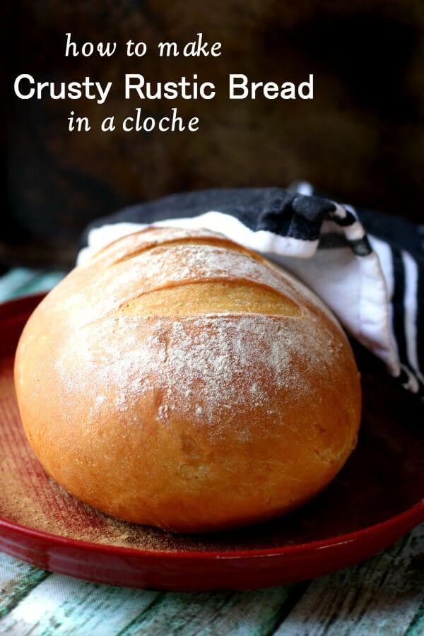 An unsliced loaf of rustic bread on a tray - title image