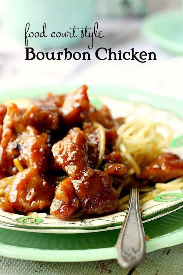 Closeup of bourbon chicken spooned over noodles on a vintage plate. Title image.