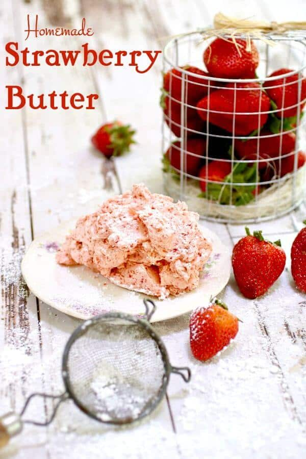 A mound of fresh strawberry butter on a plate with a container of fresh strawberries near by.