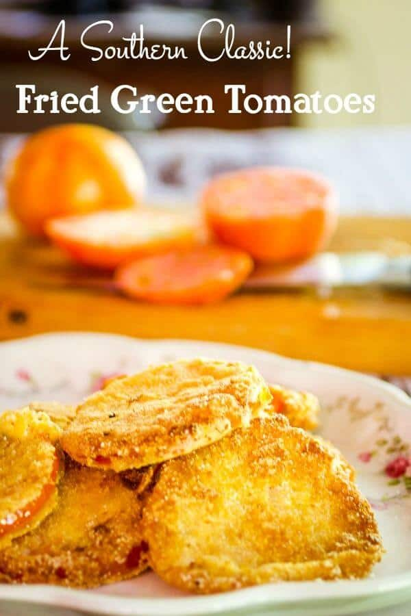 Fried green tomatoes recipe -title -fried green tomatoes on a platter with sliced tomatoes in the background.
