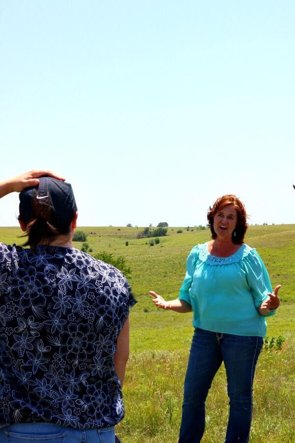 Debbie Lyons-Blythe in a Kansas pasture