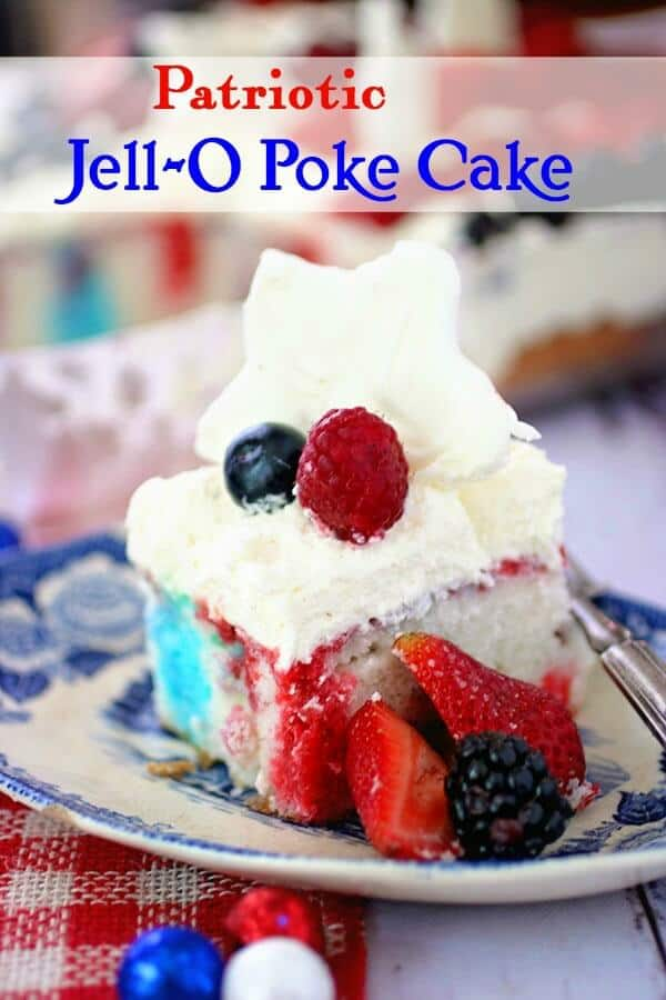 A square of Jello poke cake streaked with red and blue Jello and a white chocolate topping