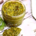 close up of chimichurri sauce in a jelly jar