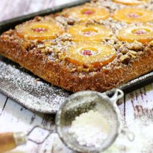 Pineapple upside down cake on a baking sheet.