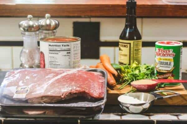 The ingredients for this Swiss Steak recipe on a counter.