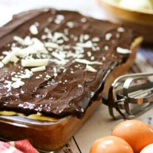 A chocolate glazed cake in a glass pan