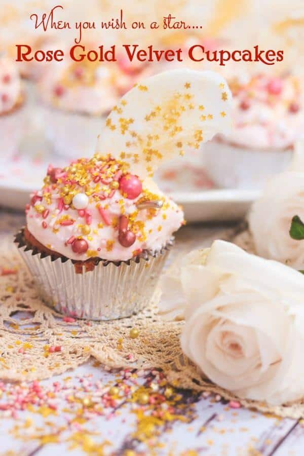 A cupcake placed in front of a tray of cupcakes with a pink, dreamy look.