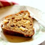 A thick slice of whiskey apple cake to illustrate the recipe card.