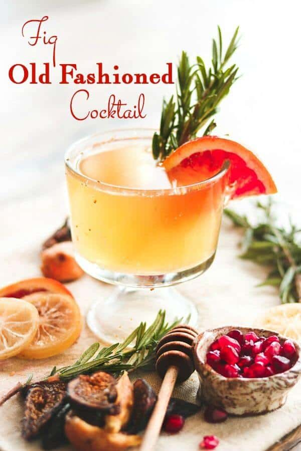 A bright bourbon cocktail with rosemary and orange garnish. Title image