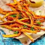 Sweet potato fries on a brown newspaper - feature image