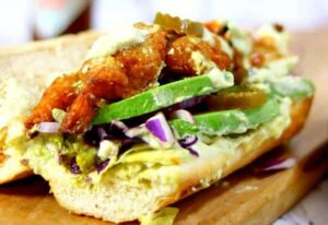 Closeup of the shrimp po' boy sandwich with drippy remoulade
