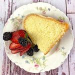A slice of poundcake with berries on it.