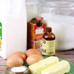 All of the ingredients for buttermilk poundcake on a table.
