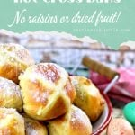 Hot cross buns surrounded by Easter eggs with text overlay for Pinterest.