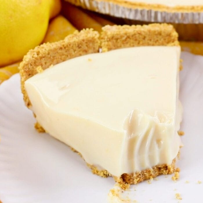 Closeup of a slice of lemon pie with a bite taken out of it for social media shares.