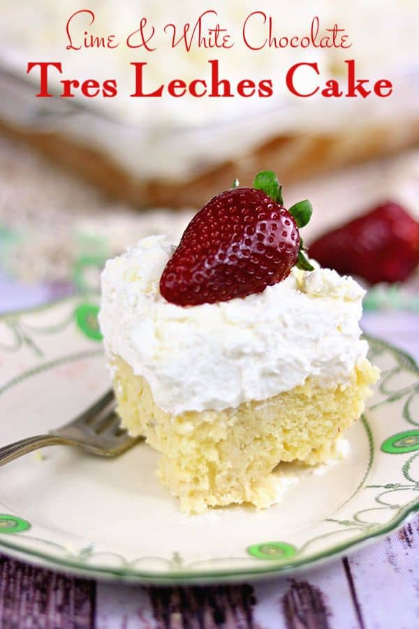 A serving of tres leches cake with thick whipped cream topping on a plate.
