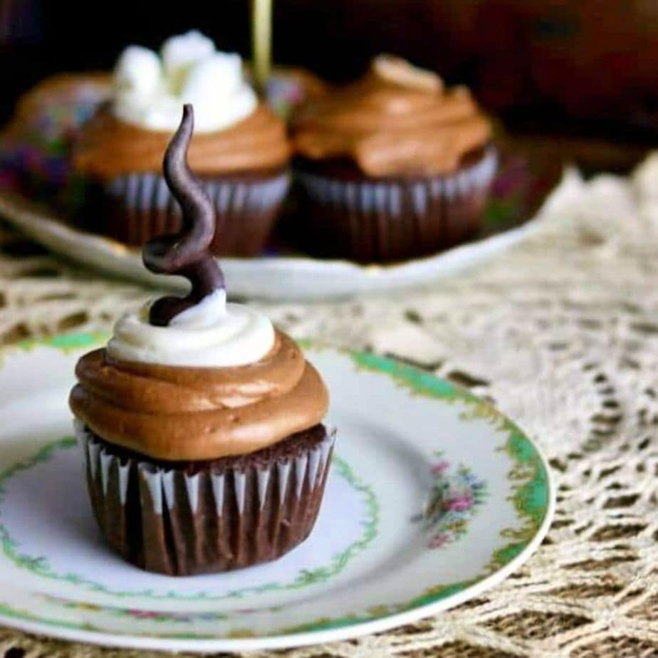 Mexican hot chocolate cupcake on a plate with a chocolate candy garnish