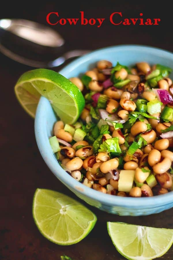 Black eyed peas salad with lime in a blue bowl - title image
