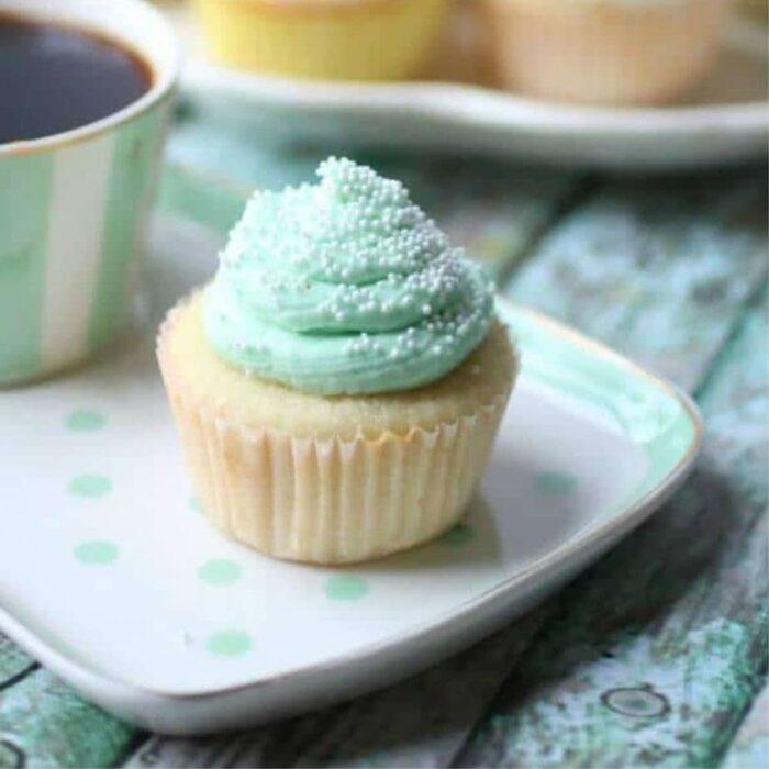 Vanilla cupcake with a mint green buttercream