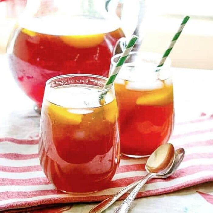 a closeup of a glass of peach tea.